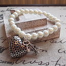 Pearl beaded heart charm bracelet
