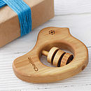 Thumb personalized organic wooden rattle