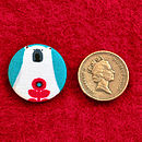 Each badge is 2.5cm in diameter, slightly bigger than a pound coin