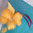 Turquoise Sinamay, Old Gold Flower, Purple Veiling, Burgundy Feather