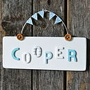 White Sign with Blue Bunting