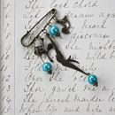 vintage style brooch with teal beads