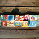 Blue Skies And Beach Huts Sign