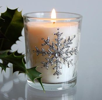 Single snowflake candle lit