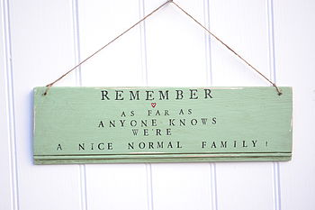 'Remember We're A Normal Family' Sign