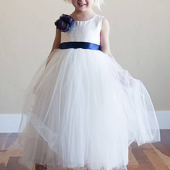 white flower girl dress with blue flower and blue sash