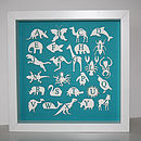 white animals on a turquoise background