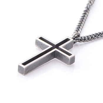 Outline silver cross pendant, oxidised finish.