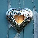 Thumb embossed cut out heart t light