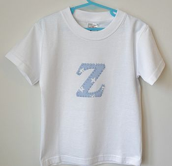 White t-shirt with blue/white stars
