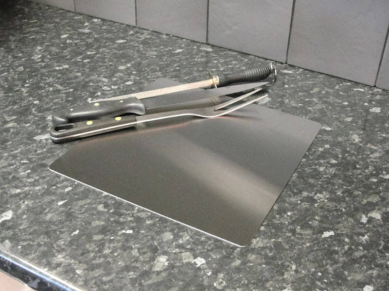Stainless worktop protector chopping board by the metal