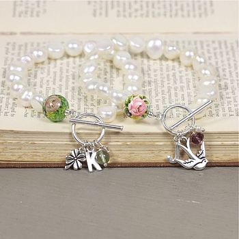 Left-Green rose bead, aventurine, vintage pink glass bead, clover charm. Right-white rose bead, purple swarovski crystal, freshwater pearl, swallow charm