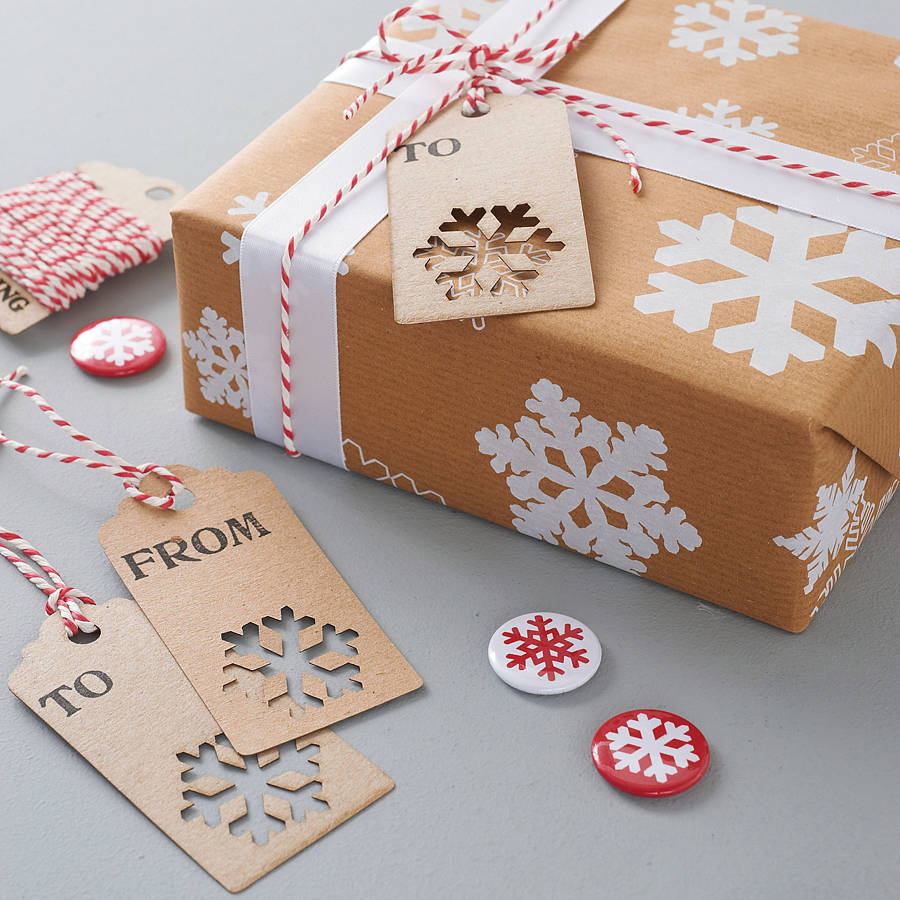 Recycled christmas snowflake gift wrap by sophia victoria for How to wrap presents with wrapping paper