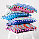 Popper Oblong Cushion_Buttonbox Oblong cushion stack on chair