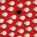 Red tie with cartoon sheep, detail