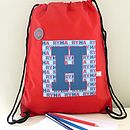 red bag with navy initial