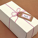 Each bottle is packaged in a white box, with red and white stripe string and optional personalised gift tag