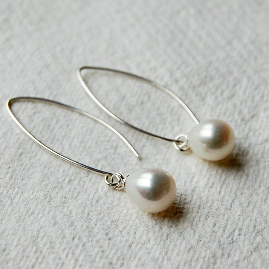 long pearl drop earrings by highland angel ...