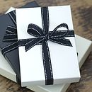 All our books arrive beautifully presented in either an ivory or a black gift box