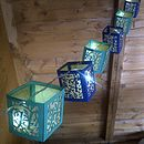 String of fairy lights in royal blue and emerald with gold vellum