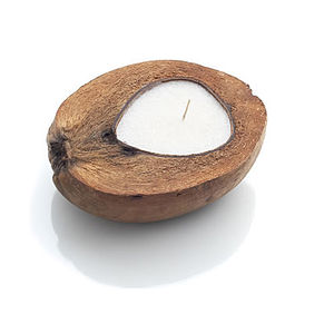 A Organic Coconut Candle In Natural Husk - candles & candlesticks