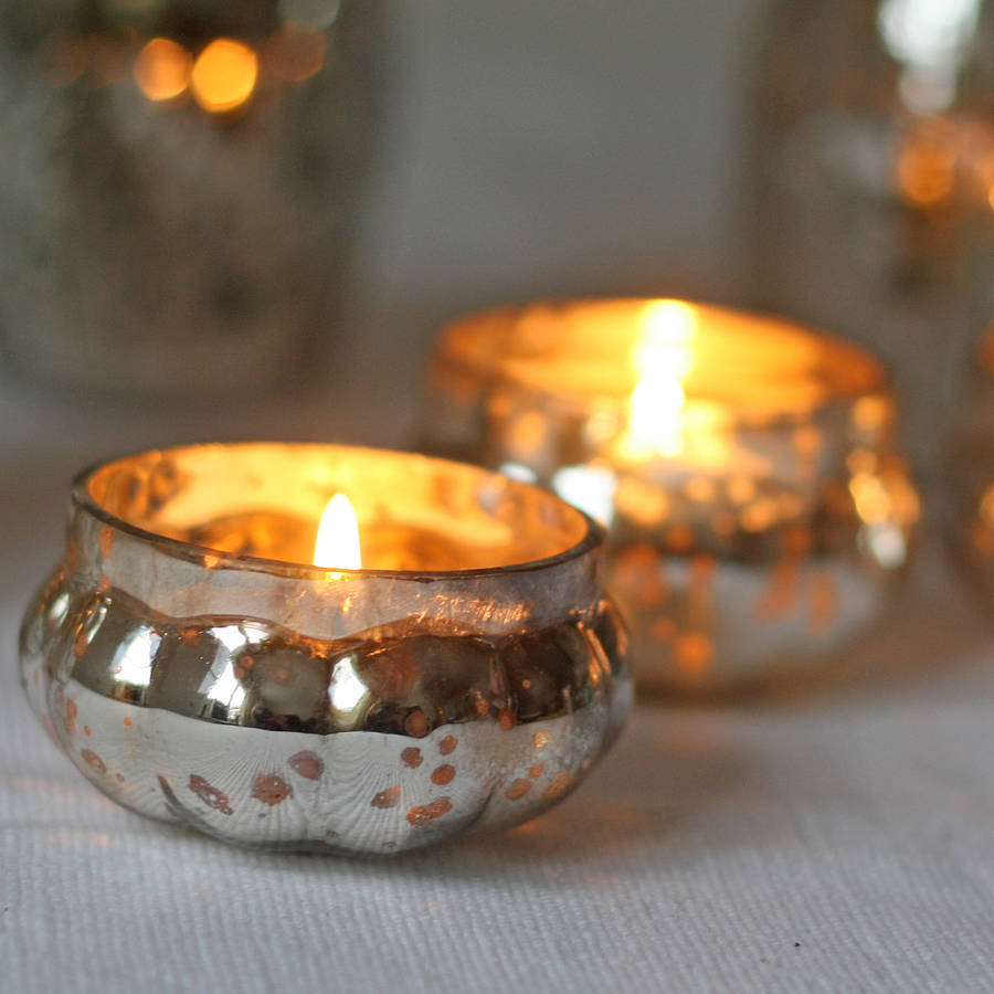 The Hobnail Votive Tea Light Candle Holder holds your favorite tea light candles in style. Constructed of glass, these holders boast a transparent exterior, allowing your candles to .