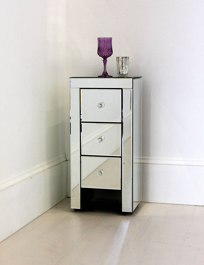 narrow mirrored bedside table by out there interiors