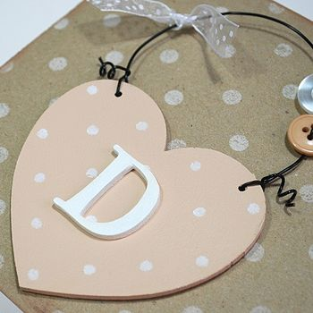cream dotty heart with white initial