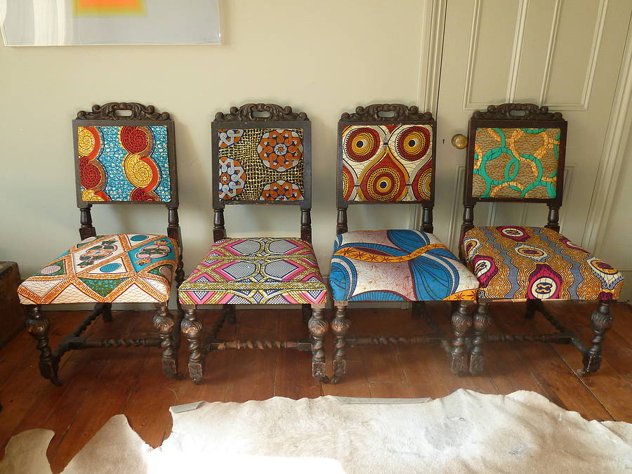 Set of four tribal print covered chairs by blanche dlys for Printed upholstered dining chairs