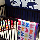 Quilted mat on cot