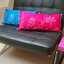 Pink and teal cushions