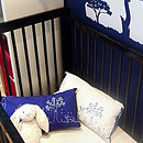 Navy and white cushions in cot