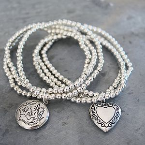 Cluster Of Bracelets With Locket
