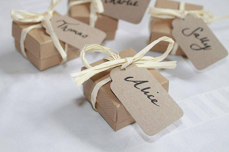 filled wedding favour boxes / place setting by dottie and belle