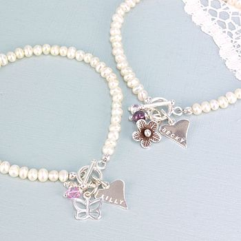 Butterfly with vintage pink glass bead and swarovski crystal, daisy with amethyst and swarovski crystal