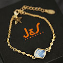 white opal bracelet with initial star