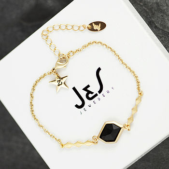 jet bracelet on white box