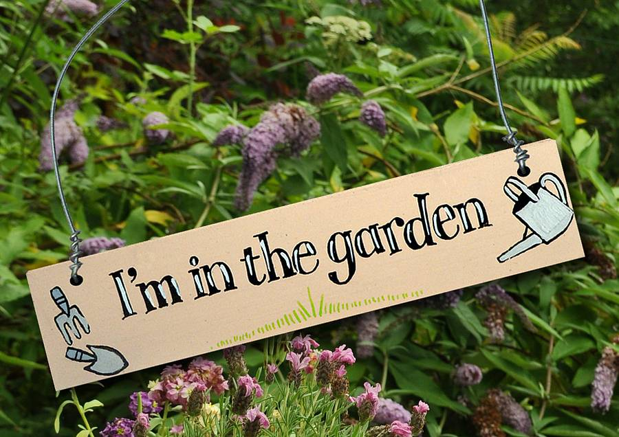 cream hand painted wooden in the garden sign by angelic hen