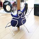 White guitar stand with bass guitar