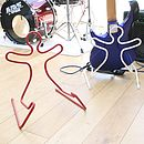 Red and white guitar stands with bass guitar