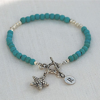 Turquoise gemstone with starfish charm