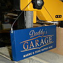 Sign for daddy's Garage in Blue