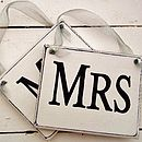 grey organza ribbons on white signs