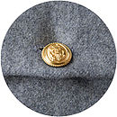 Grey wool back and vintage brass anchor button detail