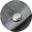 Grey wool back and vintage uniform crown button detail.