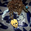 Gold And Silver Skull Necklaces