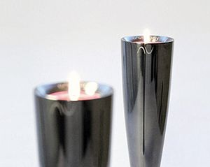 Two Polished Black Candlesticks And Vases - table decorations