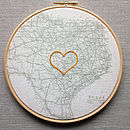 Vintage map in hoop with embroidered heart