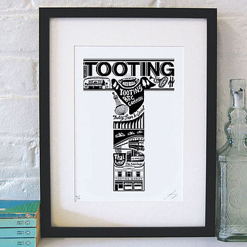 Tooting print with black frame and white mount