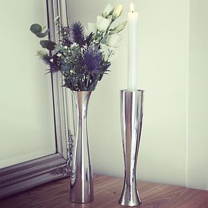 Two Polished Silver Candlesticks And Vases - table decorations